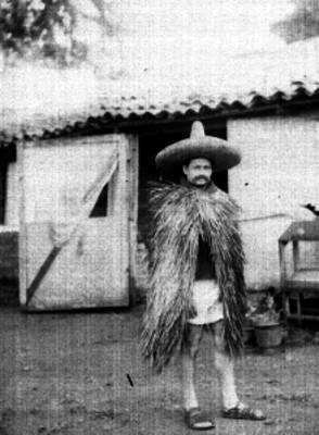 Indígena con capote de palma, retrato