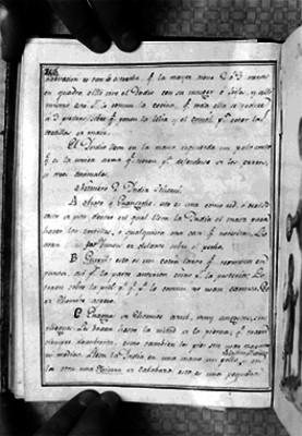 Página de libro con letra manuscrita