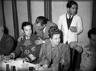 Jorge Negrete y Mapi Cortés durante una cena ofrecida por artístas de cine a Miguel Alemán Valdés en un salón