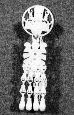 Vista de un pendiente, joyería mixteca