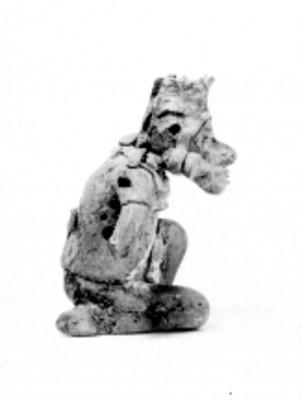 Escultura antropomorfa, vista de perfil