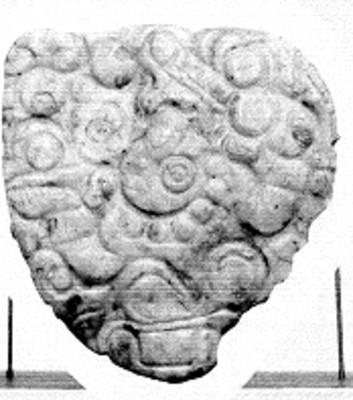 Adorno pectoral, vista frontal