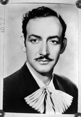 Copia fotografica de Jorge Negrete de frente con saco y corbata de charro, retrato