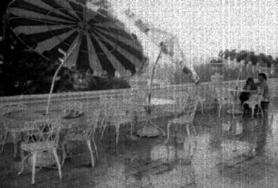 Pareja en una cafeteria del Parque Juárez