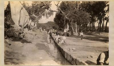 """Gente lava ropa y se baña en un canal """"6275. Bathing scenes at hot spring acequia"""""""