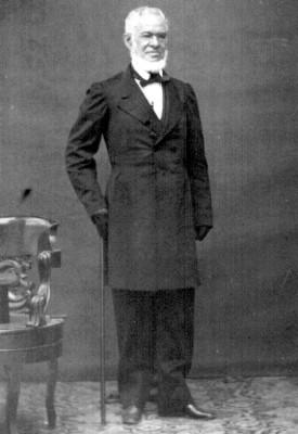 Hombre de traje y con bastón, tarjeta de visita