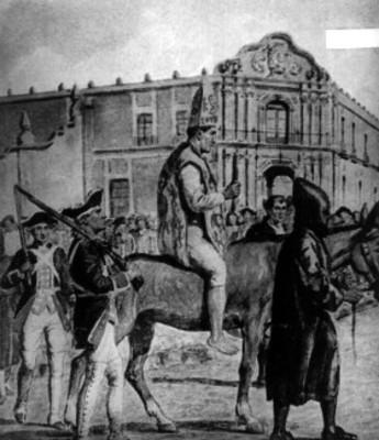 Condenado va a purgar su sentencia a su paso frente al edificio de la Santa Inquisición y es conducido por su verdugo