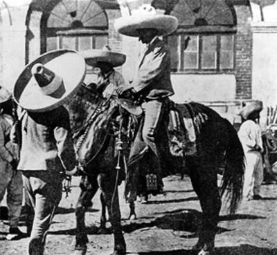 Emiliano Zapata a caballo conversa con Francisco Pacheco