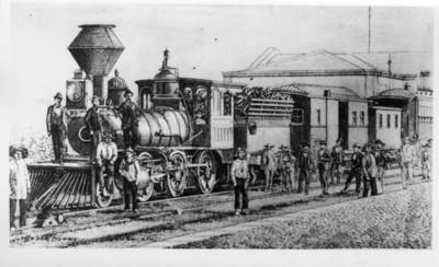 Tren parado en una estación de ferrocarril junto a unos hombres, litografía