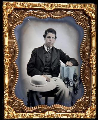 Hombre con sombrero, retrato