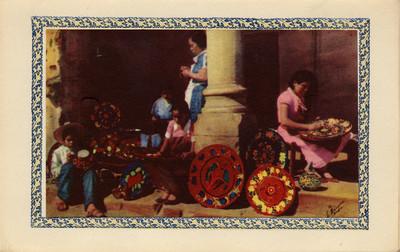 Mujeres y niño pintan cerámica, tarjeta navideña