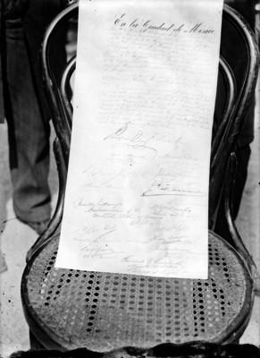 Documento en que queda plasmado el acto de colocación de la primera piedra del Monumento a la Independencia de México