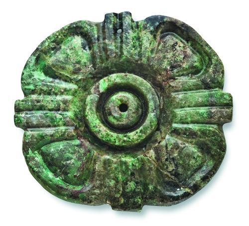 Ornamento tallado en forma de flor