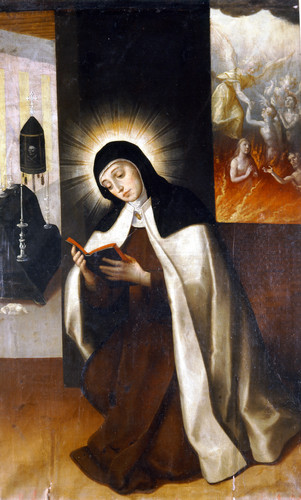 Santa Teresa orando por las ánimas del Purgatorio