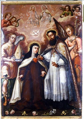 San Agustín escribiendo en el corazón de santa Teresa