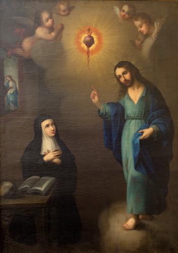 Santa Margarita Alacoque hincada adorando al Sagrado Corazón
