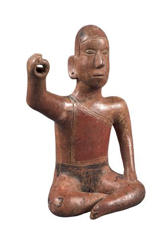 Figura masculina hueca sedente